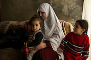 Aley, LEBANON: Maamna Al Msalem, 31, with her duaghters, 11-month old Raghdaa and four-year old Maryam. They came from Saaba, outside of Damascus. They left at the beginning of 2012. The father was a carpenter and did cabinetry and similar work.<br />