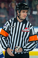 KELOWNA, CANADA - DECEMBER 7:  Referee Mike Langin stands at centre ice at the Kelowna Rockets against the Victoria Royals on December 7, 2018 at Prospera Place in Kelowna, British Columbia, Canada.  (Photo by Marissa Baecker/Shoot the Breeze)