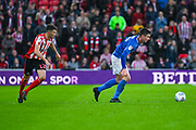 Oliver Hawkins of Portsmouth (9) and Tom Flanagan of Sunderland (12) in action during the EFL Sky Bet League 1 first leg Play Off match between Sunderland and Portsmouth at the Stadium Of Light, Sunderland, England on 11 May 2019.