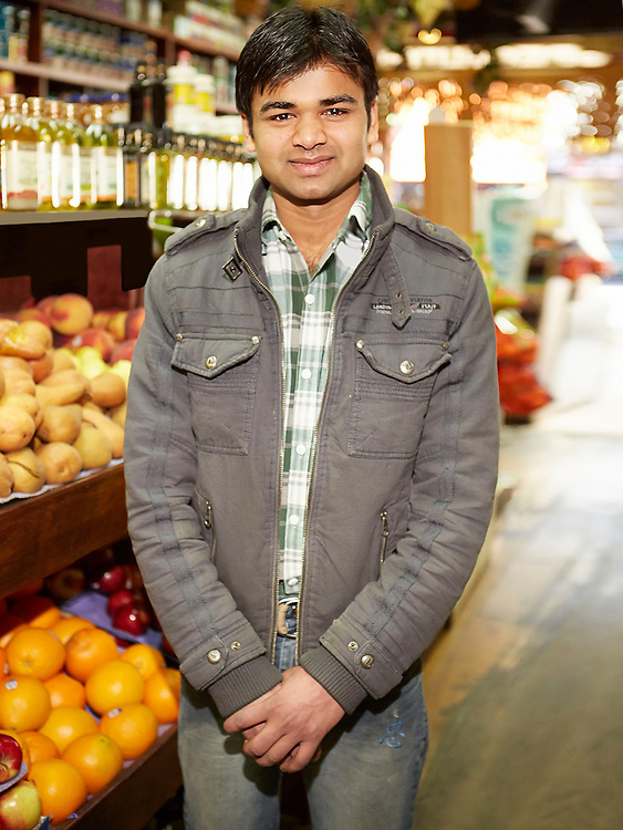 Portrait photograph of Indian in vegetable market