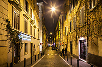 ROME, ITALY - 20 MARCH 2017: Old yellow sodium street lights, that have not been yet subsituted by white LED lights, illuminate the Monti neighborhood in Rome, Italy, on March 20th 2017.<br /> <br /> Rome is undergoing a city-wide plan to change its public illumination from the current yellow sodium street lights CK to white LED lamps. In making the change, Rome joins a long line of cities around the world that have switched to the cheaper, and more environmentally friendly LED lighting, and it is not the first city where that change has come at the price of protest.<br /> <br /> Since July, some 100,000 led lights have already been installed, just over half the number that will be substituted in the 53 million euro changeover that is expected to save the city millions of euros in electrical bills. But when Rome's municipal electrical utility ACEA began to substitute the lamps in Rome's historic center, residents began to take note.