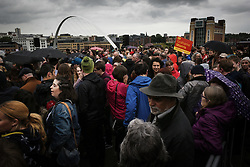 © Licensed to London News Pictures. 05/06/2017. Newcastle Upon Tyne, UK. Newcastle's Millenium Bridge and Baltic Art Gallery form the backdrop to a crowd of hundreds who waited in the rain to Jeremy Corbyn MP, Leader of the Labour Party speak outside the Sage in Gateshead. Mr Corbyn spent one of the final days of the campaign trail in the Labour heartlands of North-East England before voters go to the polls in the UK General Election on June 8th 2017. Photo credit: MARY TURNER/LNP