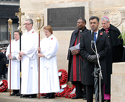 © Licensed to London News Pictures. FILE PICTURE dated 08/11/2009 of Farooq Siddique (pictured right at microphone) at Remembrance Sunday, amongst religious representatives at the Bristol Cenotaph. FAROOQ SIDDIQUE, age 46, appeared today (28/07/2015) at Bristol Magistrates Court charged with three counts of rape, two counts of assault causing actual bodily harm, and one of making a threat to kill. A police spokesman said the charges related to a period between 2009 and 2014. Farooq Siddique is an ex-government adviser, the south west manager for the Government's Prevent strategy, aimed at tackling radicalisation and extremism, and held that position until 2012. He is also a former spokesman and community development officer for the Bristol Muslim Society, is well known within the Muslim community of Bristol, and has spoken out on issues such as terrorism and radicalisation on both a national and city-wide stage.  He was a voluntary Sunday school teacher at Islamic institutions across the city and worked with most of the city's mosques. He was involved with the making of a BBC docu-drama about the radicalisation of Bristol bomber Isa Ibrahim. Photo credit : Simon Chapman/LNP