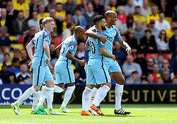 Manchester City's Vincent Kompany celebrates the opening goal with Sergio Aguero during the Premier League match at Vicarage Road, Watford.