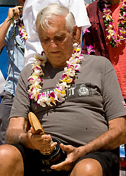 March 6, 2018 - FILE - Big-wave pioneer, surf innovator, mentor and historian George Downing has passed away at 87. Born and raised in Honolulu, Downing surfed Hawaii in the '40s on finless Hot Curls made out of redwood. He was a surfer responsible for many firsts in the sport, and in 1950 he produced the first surfboard with a removable fin. Eight years later he and a handful of other surfers rode 30 foot waves at Makaha, pushing the boundaries of what was believed to be possible at the time. Pictured: Aug. 05, 2011 - Huntington Beach, California, U.S. - GEORGE DOWNING looks at his award following his induction into the 2011 Surfers Hall of Fame in front of Huntington Surf & Sport..(Credit Image: © Mark Rightmire/The Orange County Register/ZUMAPRESS.com)