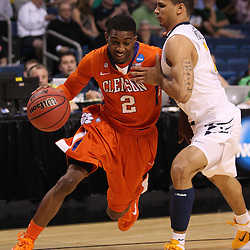 Mar 17, 2011; Tampa, FL, USA; Clemson Tigers guard Demontez Stitt (2) drives past West Virginia Mountaineers guard Joe Mazzulla (21) during the first half of the second round of the 2011 NCAA men's basketball tournament at the St. Pete Times Forum.  Mandatory Credit: Derick E. Hingle