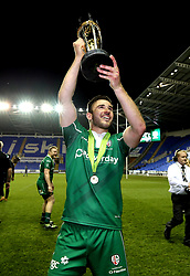 Tommy Bell of London Irish with the Greene King IPA Championship Final trophy - Mandatory by-line: Robbie Stephenson/JMP - 24/05/2017 - RUGBY - Madejski Stadium - Reading, England - London Irish v Yorkshire Carnegie - Greene King IPA Championship Final 2nd Leg