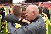 An emotional Burton Albion manager Nigel Clough and Burton Albion coach Andy Garner celebrate with goal-scorer Burton Albion striker Luke Varney (19) on Burton Albion staying in the Championship in only their first season in the second tier during the EFL Sky Bet Championship match between Barnsley and Burton Albion at Oakwell, Barnsley, England on 29 April 2017. Photo by Richard Holmes.