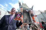 Los Angeles Mayor Eric Garcetti receives the first commemorative, full-color souvenir program to mark the 90-year history of the TCL Chinese Theatre.  (Photo by Ringo Chiu)<br />   (Photo by Ringo Chiu)<br /> <br /> Usage Notes: This content is intended for editorial use only. For other uses, additional clearances may be required.