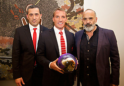 ADELAIDE, AUSTRALIA - Sunday, July 19, 2015: Liverpool's manager Brendan Rodgers and is presented with a football designed by Aboriginal artist Jacob Stengle [R] also pictured is South Australia Treasurer Tom Koutsantonis during a visit to the Art Gallery of South Australia ahead of a preseason friendly match against Adelaide United on day seven of the club's preseason tour. (Pic by David Rawcliffe/Propaganda)