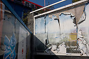 Peeling billboard poster sheets near 2012 Olympic Park construction site in Stratford.