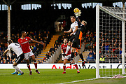 Fulham defender Tomas Kalas (26) fouls Barnsley goalkeeper Adam Davies (1) during the EFL Sky Bet Championship match between Fulham and Barnsley at Craven Cottage, London, England on 23 December 2017. Photo by Andy Walter.