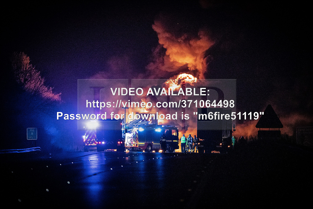 """© Licensed to London News Pictures. 05/11/2019. Coventry, UK. VIDEO AVAILABLE AT: https://vimeo.com/371064498 - password for download is """"m6fire51119"""". A lorry fire on the South-East bound carriageway of the M6 north of Coventry prompts police to close the motorway to all traffic in both directions whilst firefighters tackle the blaze . Miles of traffic tails back and the route is expected to remain closed for several hours . Photo credit: Joel Goodman/LNP"""