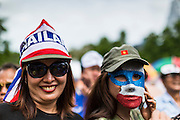 04 AUGUST 2013 - BANGKOK, THAILAND:      Women at a rally against former Prime Minister Thaksin Shinawatra and the current Prime Minister, Yingluck Shinawatra, his sister. About 2,000 people, members of the  People's Army against Thaksin Regime, a new anti-government group, protested in Lumpini Park in central Bangkok. The protest was peaceful but more militant protests are expected later in the week when the Parliament is expected to debate an amnesty bill which could allow Thaksin Shinawatra, the exiled former Prime Minister, to return to Thailand.   PHOTO BY JACK KURTZ