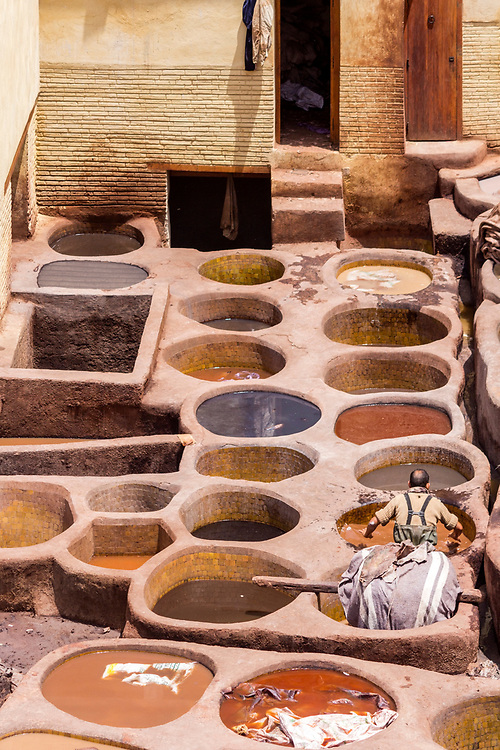 Fes el Bali worker the dye pots at leather traditional tanneries in the ancient medina, in Fez, Morocco.