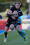 Saracens right wing Ali Crossdale (14) tackled by Worcester Warriors fly-half Jamie Shillcock (10) during the Premiership Rugby Cup match between Saracens and Worcester Warriors at Allianz Park, Hendon, United Kingdom on 11 November 2018.