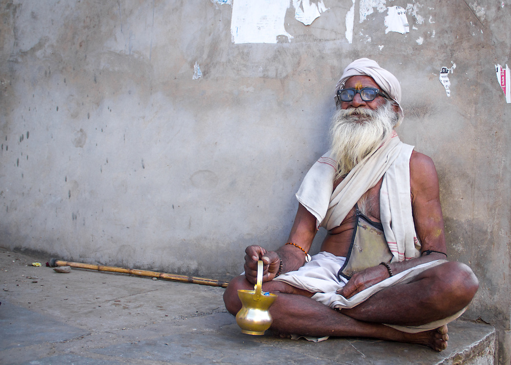 A hindu sadhu (holy man) asking for small change on the streets of Udaipur, India.