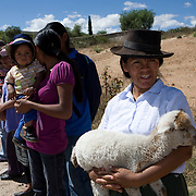 The CARE Learning Tour group is welcomed to the village of Neque, near Ayacucho, where CARE is working to support community activities.  Microfinance programs use a proven community based group savings and loans methodology as an entry point to mobilize group members to address a wide range of constraints to the social and economic empowerment of marginalized women and girls. ..Women in the community have said that when they first joined the group their husbands didn't take much notice. Now they are working with their husbands to discuss loans and business plans and ways to help their families. The group meets monthly and provides support to each other both financially and by sharing their experiences with their individual businesses. ..Increasing access to financial services for the poor must be part of an integrated and holistic approach to community empowerment in order to effectively address maternal health. Such an approach acknowledges the deep inequities that shape health seeking behaviors and would marry supply and demand by strengthening health systems and service delivery on the one hand while building community pressure for quality care on the other. ..