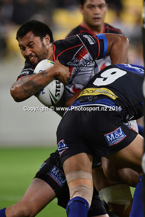 Warriors' Ligi Sao is tackled by Bulldogs' Michael Lichaa during the NRL Warriors vs Bulldogs Rugby League match at the Westpac Stadium in Wellington on Saturday the 16th of April 2016. Copyright Photo by Marty Melville / www.Photosport.nz