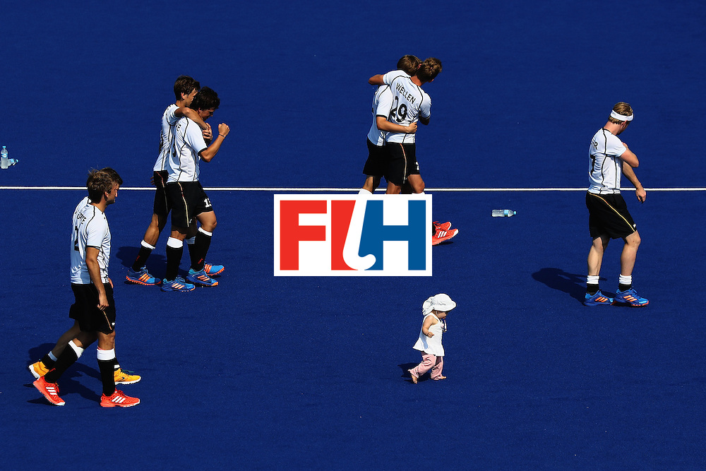 RIO DE JANEIRO, BRAZIL - AUGUST 18:  Team Germany with one of their children walk off the field after defeating Netherlands in a penalty shootout during the Men's Hockey Bronze medal match at the Olympic Hockey Centre on Day 13 of the 2016 Rio Olympic Games on August 18, 2016 in Rio de Janeiro, Brazil.  (Photo by Sean M. Haffey/Getty Images)