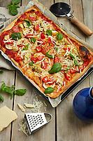 Motiv: Pizzabak<br /> Recept: Katarina Carlgren<br /> Fotograf: Thomas Carlgren<br /> Användningsrätt: Publ en gång<br /> Annan publicering kontakta fotografen