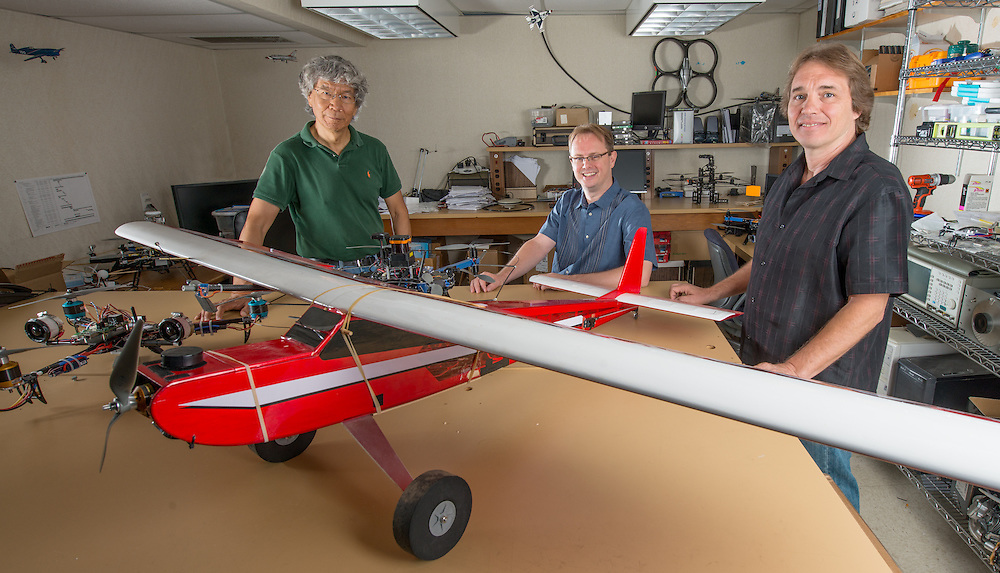 Russ College of Engineering faculty (Left to Right) Jim Zhu, Maarten Uijt De Haag  and Tony Adami collaborate on work related to unmaned aerial vehicles. Photo by Ben Siegel/ Ohio University