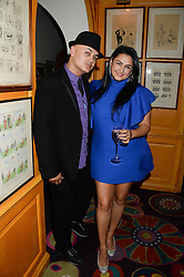 STUART WATTS and KIRAN SHARMA at a 1970's themed party as part of Annabel's 50th anniversary celebrations, held at Annabel's, Berkeley Square, London on 24th September 2013.