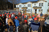 A large contingent of DASA and facilities staff get split into work details at the Build-A-Block Habitat for Humanity project.