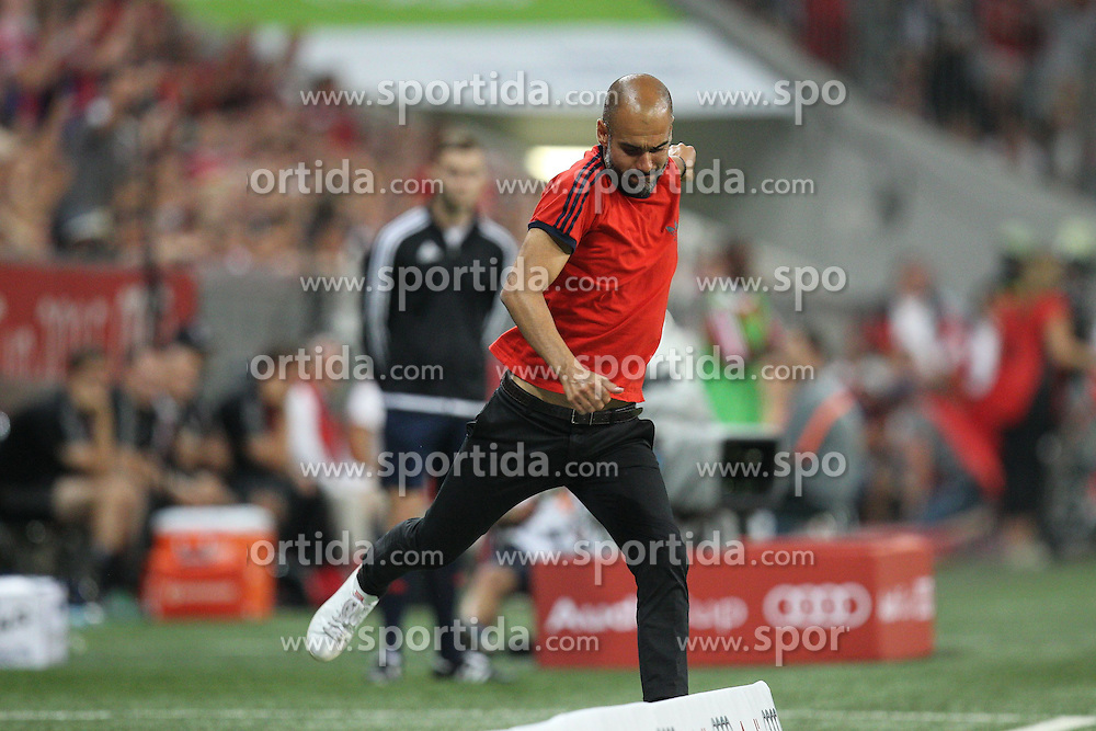 04.08.2015, Allianz Arena, Muenchen, GER, AUDI CUP, FC Bayern Muenchen vs AC Mailand, im Bild Chef-Trainer Pep Guardiola (FC Bayern Muenchen) triit wuetend gegen die Bande // during the 2015 AUDI Cup Match between FC Bayern Muenchen and AC Mailand at the Allianz Arena in Muenchen, Germany on 2015/08/04. EXPA Pictures &copy; 2015, PhotoCredit: EXPA/ Eibner-Pressefoto/ Kolbert<br /> <br /> *****ATTENTION - OUT of GER*****