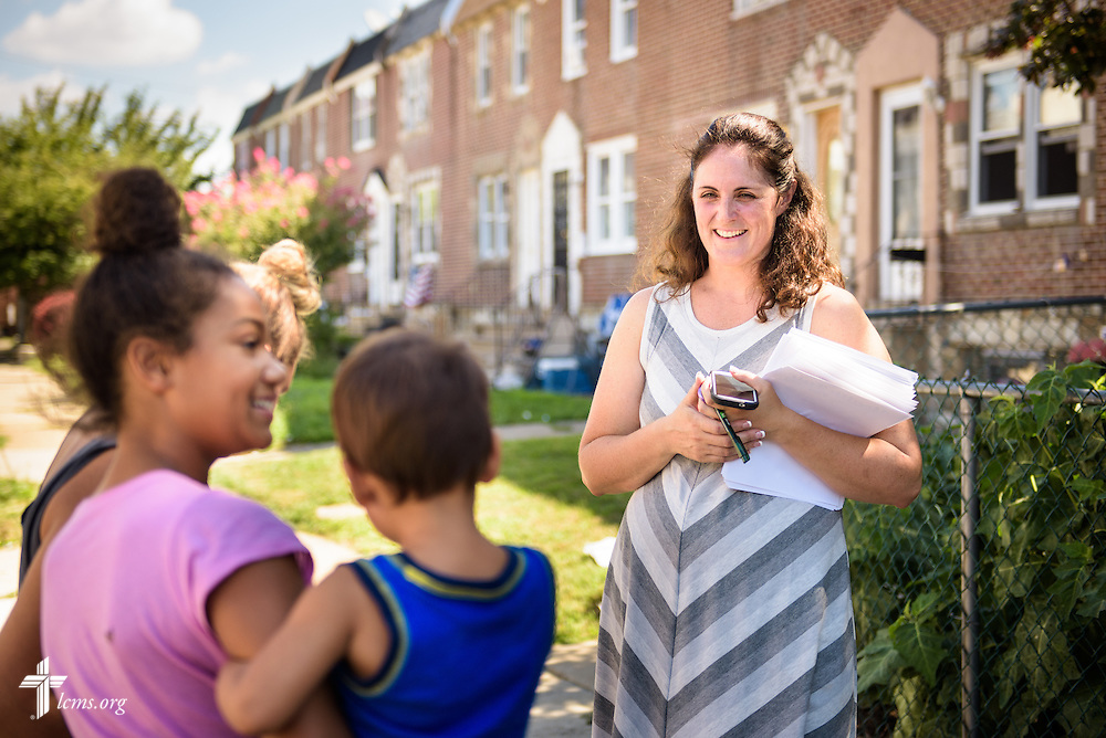 Deaconess Melissa DeGroot distributes flyers for the domestic Mercy Medical Team on Friday, Aug. 26, 2016, in a neighborhood near Shepherd of the City Lutheran Church in Philadelphia. LCMS Communications/Erik M. Lunsford
