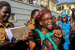 """Apr 26, 2017 - Kampala, Uganda - Dr. STELLA NYANZI is led out of the High Court and taken back to maximum security Luzira prison. The prominent feminist and LGBT activist, was arrested last April after calling the President """"a pair of buttocks"""" and criticising the first lady on her Facebook page. She has been charged with """"cyber harassment"""" and will remain in custody at maximum security Luzira prison. Her next bail hearing is scheduled to take place on May 10. (Credit Image: © Sumy Sadurni via ZUMA Wire)"""