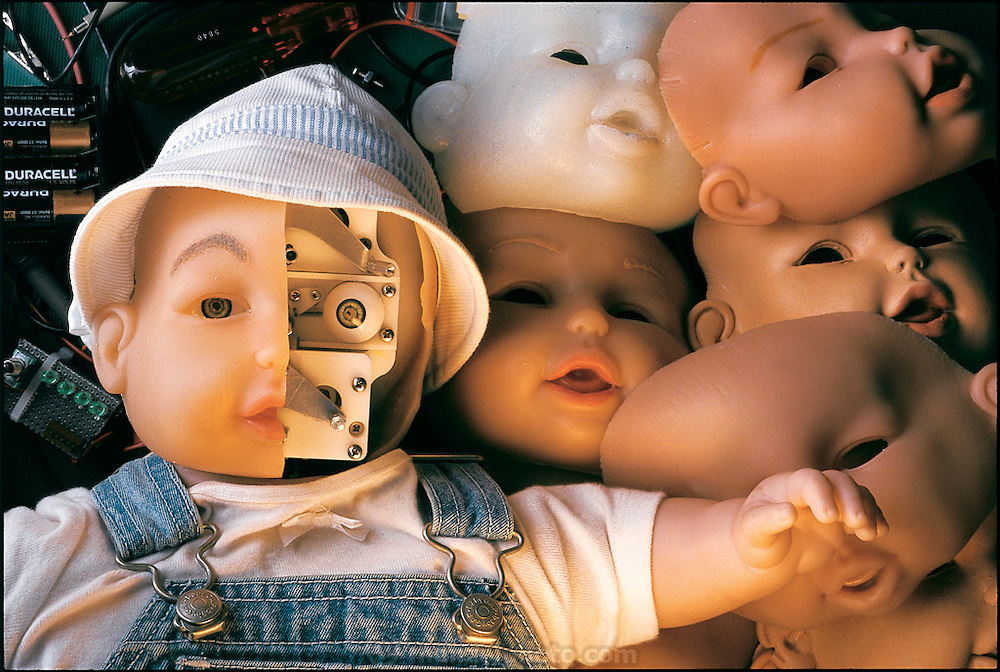 """Baby It"" is the prototype for My Real Baby, the most sophisticated robot doll yet made. According to a press release, it is only the ""first born"" in a series of dolls created from the union of its parent companies, toy giant Hasbro and iRobot, a small Massachusetts robotics firm. Somerville, MA. From the book Robo sapiens: Evolution of a New Species, page 12-13."
