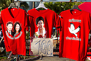 08 MAY 2013 - BANGKOK, THAILAND:  Red tee shirts for sale with photos of Thai Prime Minister Yingluck Shinawatra and former PM Thaksin Shinawatra at a Red Shirt protest. The Shinawatras are supported by the Red Shirts. A splinter group of the Red Shirts, Thai supporters of exiled Prime Minister Thaksin Shinawatra, have besieged the Thai Constitutional Court for the last three weeks calling for the resignation of the justices, who have indicated they might oppose a proposed constitutional reform which would grant amnesty to people convicted of political crimes since 2007. This would probably include Thaksin. The justices have refused to step down. Wednesday the protesters moved their protest to the Thai Parliament, which is largely powerless to intervene.  PHOTO BY JACK KURTZ