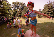 Shannon Paproski balances on a tube while wearing a ceremonial ribbon and headpiece on her grandmother's farm in Newtown, CT.