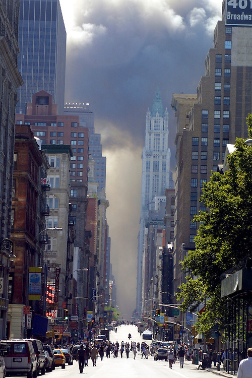 Thick smoke fills the streets of lower Manhattan after the Twin Towers were brought down by a terrorist attack on the World Trade Center, New York City, September 11, 2001. Photo by Lisa Quinones