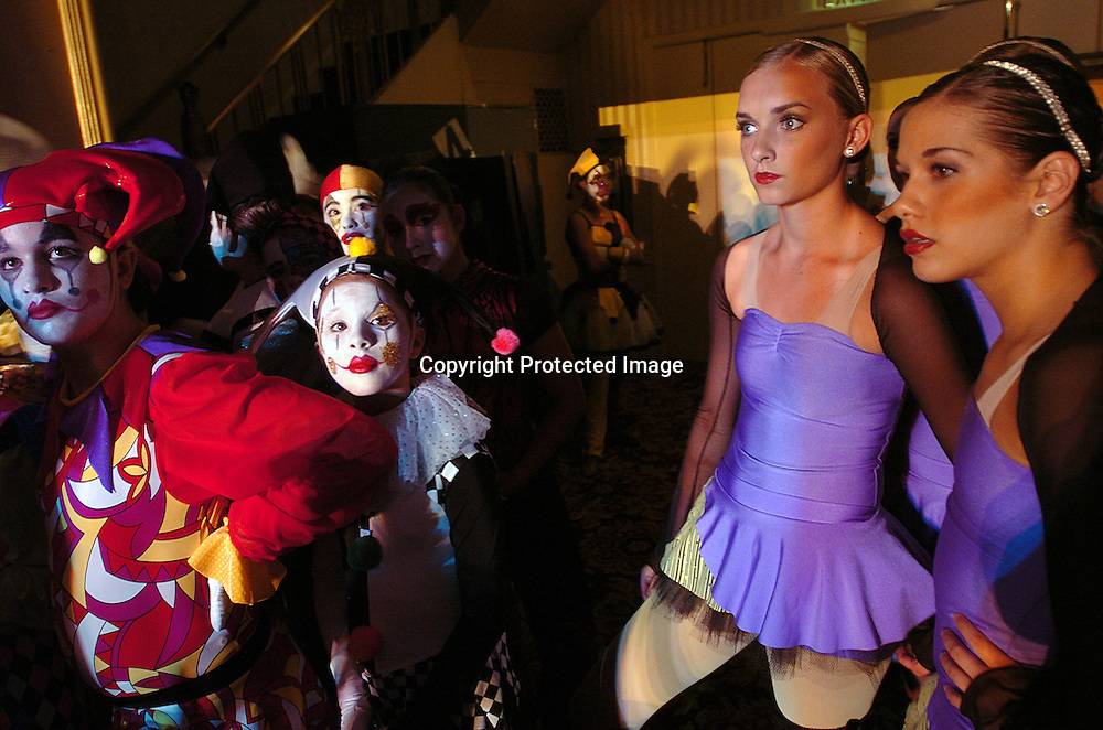 Dancers from the Dance Club(r) of Orem, Utah and Harlequin Extravaganza(l) watch another group's performance during the New York Dance Alliance's national competition finale July 5, 2005 in New York City.<br /> <br /> Photo by Keith Bedford