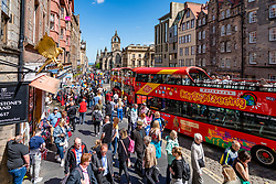 View of many tourists crowded on street at Royal Mile at Lawnmarket in Edinburgh Old Town, Scotland, UK