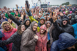 © Licensed to London News Pictures . 07/06/2014 . Heaton Park , Manchester , UK . Audience in front of the main stage . The Parklife music festival in Heaton Park Manchester following heavy overnight rain . Photo credit : Joel Goodman/LNP