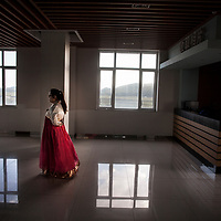 HUNCHUN, 09/12/2017:<br />  an employee dressed in traditional Korean clothes walks through a  hall at a viewpoint in Fangchuan.