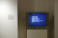 Installation shot of TV projection of legal data of 117 political prisoners following the 2004 coup d'état. Concordia Media Gallery, Montreal, 2010.