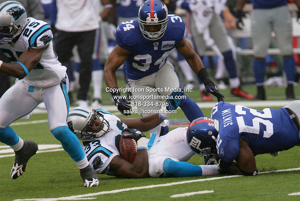September 12, 2010 The Carolina Panthers At The New York Giants At The New Meadowlands Stadium In East Rutherford New Jersey   (RB) Mike Goodson #33  (S) Marcus Hudson #25    (S) Deon Grant ##34 (LB) Clint Sintim #53