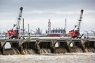 Jan. 10, 2015, Norco. Louisiana, U.S. Army Corps of Engineers workers open some of the gates of the Bonnet Carré Spillway to reduce the Mississippi's water-flow as it approaches New Orleans, directing it into Lake Pontchartrain. The Mississippi Rivers water levels were approaching flood stage as waters that flooded Missouri, are making their way to the Gulf of Mexico.