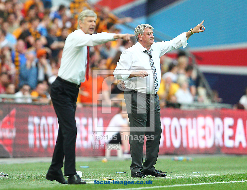 Steve Bruce ( R), Manager of Hull City during the The FA Cup Final match at Wembley Stadium, London<br /> Picture by Paul Terry/Focus Images Ltd +44 7545 642257<br /> 17/05/2014