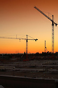 Building Cranes In The Sunset
