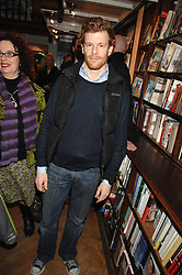 TOM AIKENS at a party to celebrate the publication of The New English Table by Rose Prince held at The Daunt Bookshop, Marylebone High Street, London on 9th April 2007.<br />