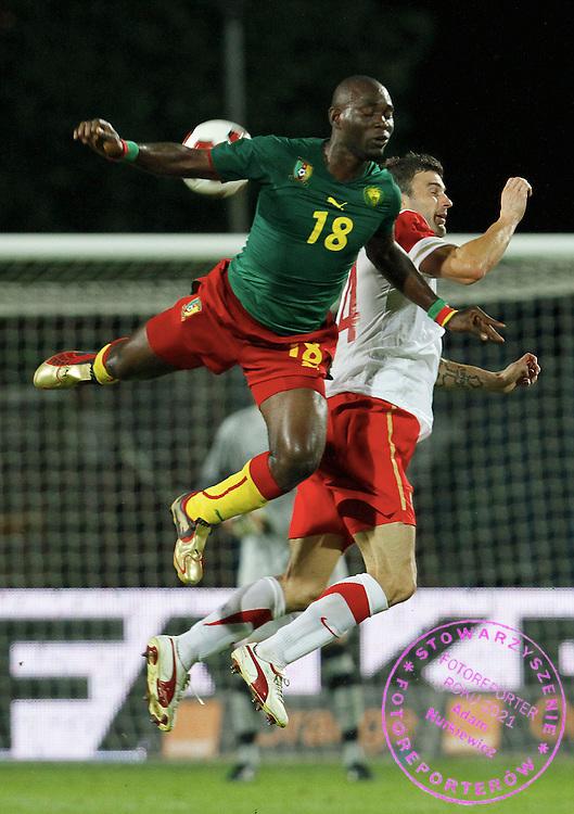 SZCZECIN 11/08/2010.FOOTBALL INTERNATIONAL FRIENDLY.POLAND v CAMEROON.Michal Zewlakow of Poland and Henri Ntsama Bienvenu of Cameroon.Fot: Piotr Hawalej / WROFOTO