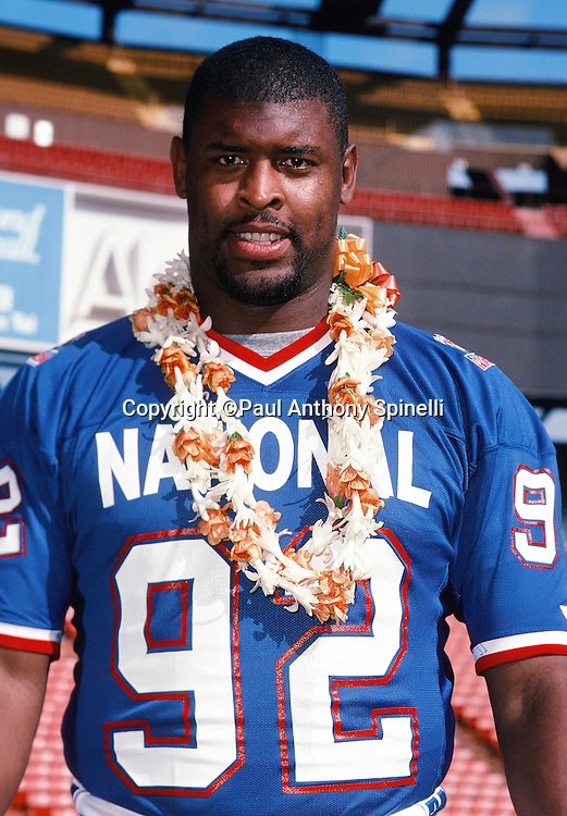 Philadelphia Eagles defensive end Reggie White (92) poses for a photo with a lei on photo day during the week of the 1990 NFL Pro Bowl between the National Football Conference and the American Football Conference on Jan. 30, 1990 in Honolulu. The NFC won the game 27-21. (©Paul Anthony Spinelli)