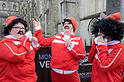 UNITED KINGDOM, Winchester: 05 March 2019 Winchester Pancake Race Photo Feature:<br /> Members belonging to the team 'Sainsbury's Badger Farm Flippin Crazies get ready before the Inaugural Winchester Pancake Race earlier this afternoon on Shrove Tuesday. The race, which consisted of 20 teams, took place in the gardens surrounding Winchester Cathedral. <br /> Rick Findler / Story Picture Agency