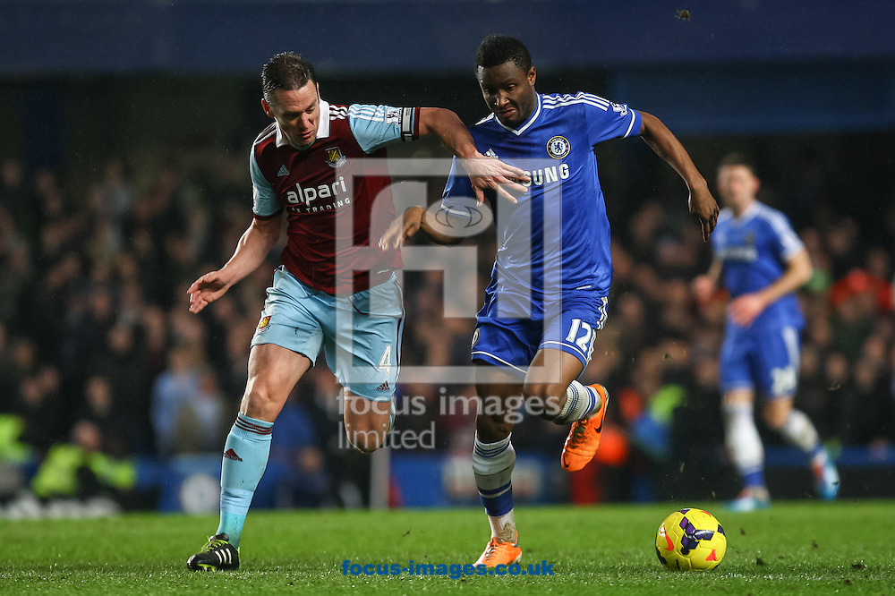 Picture by Daniel Chesterton/Focus Images Ltd +44 7966 018899<br /> 29/01/2014<br /> Kevin Nolan of West Ham United and John Obi Mikel of Chelsea compete for the ball during the Barclays Premier League match at Stamford Bridge, London.