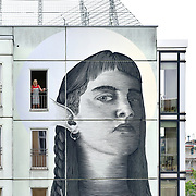 """Artist Nicolas Sanchez paints a wall for Urban Nation """"One Wall"""" series at Gewobag housing project at Mommsenstr. 40, in Berlin, Germany, in July 2017.   #OneWall #UrbanNation #UrbanNationBerlin #MuseumofUrbanAndContemporaryArt #streetart   photo by Jennifer Sanchez"""